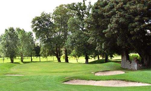 A view of hole #17 surrounded by bunkers at Adare Manor Golf Club