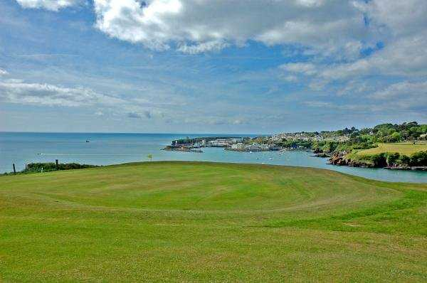 A view of a green with water in background at Dunmore East Golf Club