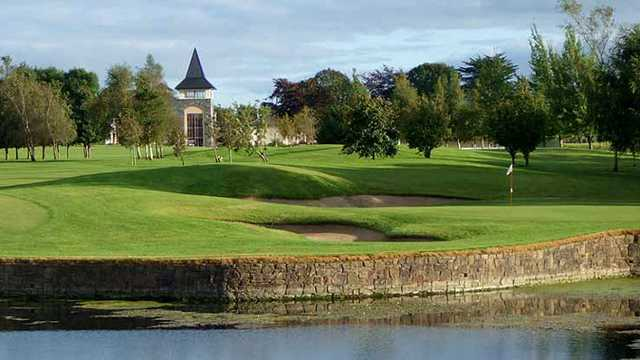 A view over the water of a hole at Ballykisteen Golf and Country Club