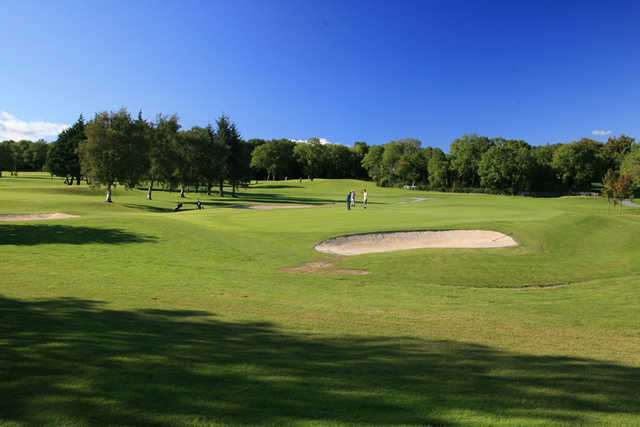 A view of a green protected by bunkers at Oughterard Golf Club