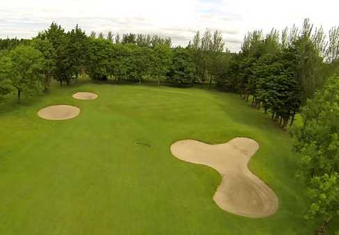 A view of a green protected by tricky sand traps at Tuam Golf Club