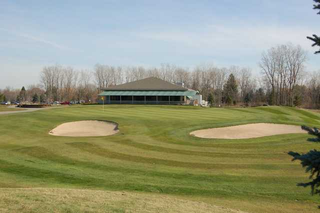 A view of the clubhouse and green #18 at Hickory Creek Golf Course