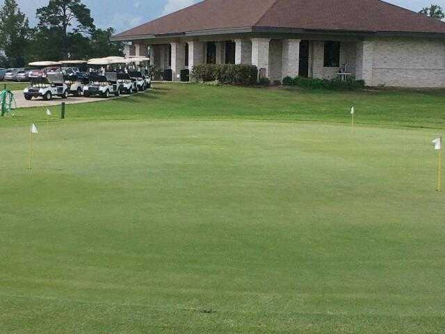 A view of the clubhouse and practice putting green at Henry Homberg Golf Course