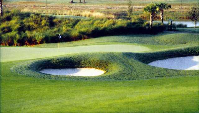 A view of a green protected by bunkers at Stoneybrook West Golf Course