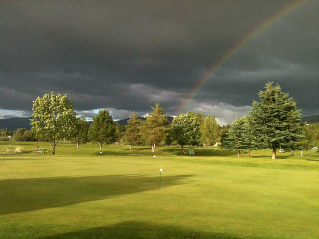 A view of a rainbow over the practice area at Linda Vista Golf Course