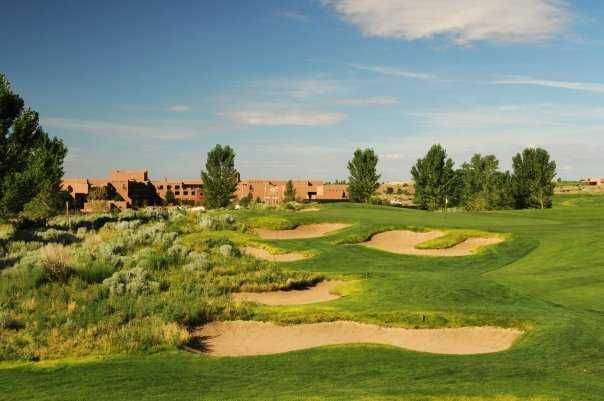 A view of a green protected by tricky bunkers at Twin Warriors Golf Club