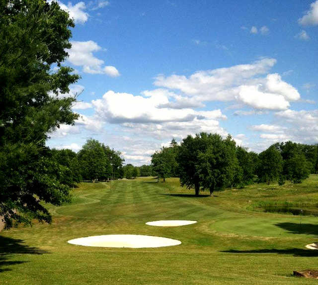 A view of a fairway and a green protected by sand traps at Kyber Run Golf Course
