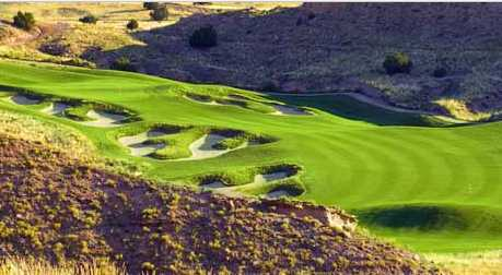 A view of hole #12 protected by tricky bunkers at Black Mesa Golf Club at Black Mesa Golf Club
