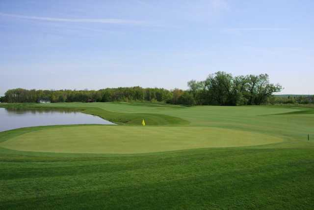 A view of the 3rd green with water coming into play at Shale Creek Golf Club
