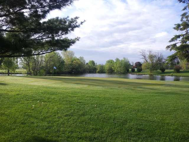 View of a green and lake at Penn Terra Golf Course