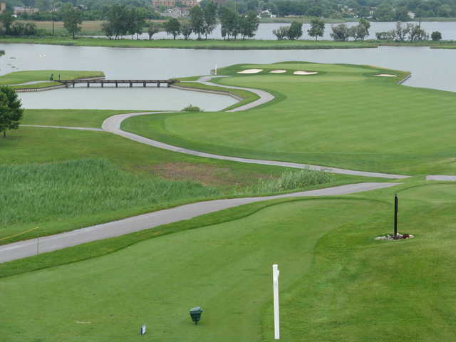View of a green and fairway at Lost Marsh Golf Course
