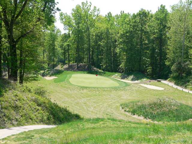A view of a green protected by tricky bunkers at Quail Crossing Golf Club