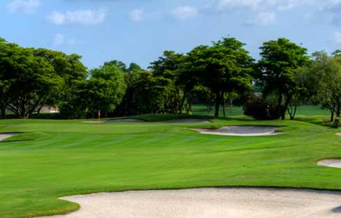 A view of a green protected by tricky bunkers at Seagate Country Club