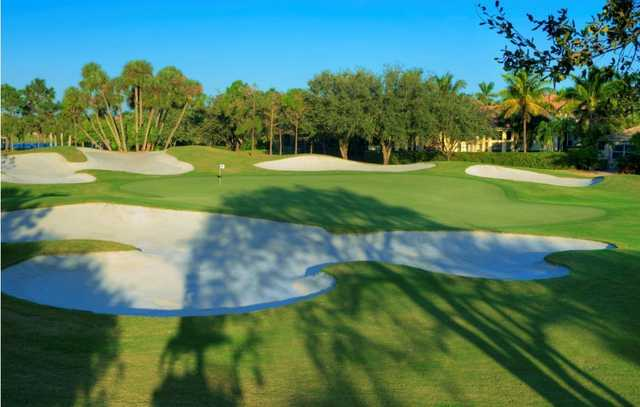 A view of a green protected by a collection of sand traps at Mizner Country Club