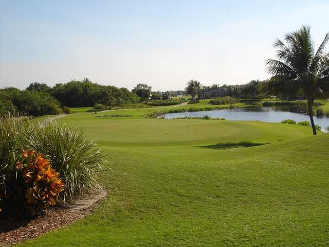 A view of a green with water coming into play at Polo Trace Golf & Country Club