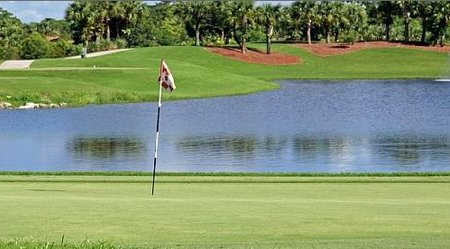 A view of green #12 with water in background at Abacoa Golf Club
