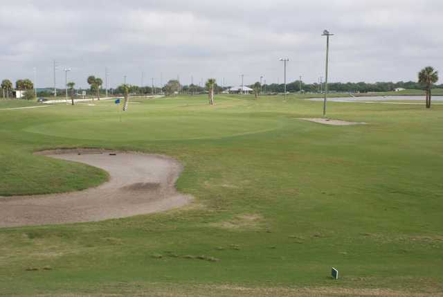 A view of a hole guarded by sand traps at Duffy's Golf Center