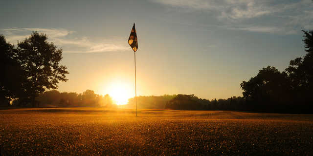 Sunrise over a green at Woodside Greens Golf Club