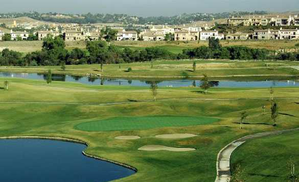 A view of a green protected by bunkers at Dos Lagos Golf Course