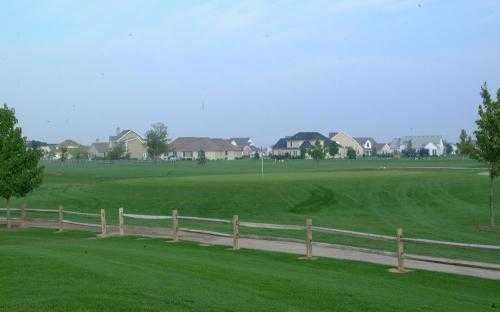 A view over the fence of the 3rd green at Fallen Timbers Fairways