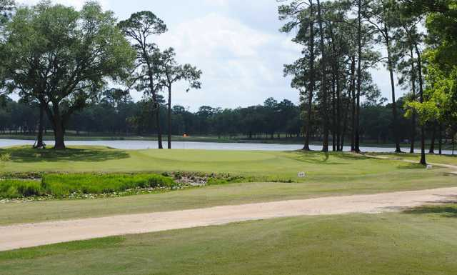 A view of green #3 with water in background at Quitman Country Club