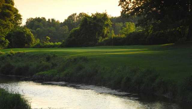A view over the water of a green at Scenic Woods Golf and Country Club