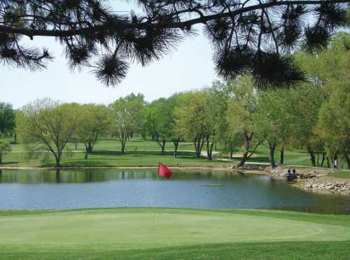 A view of a green with water coming into play at Western Hills Golf Club