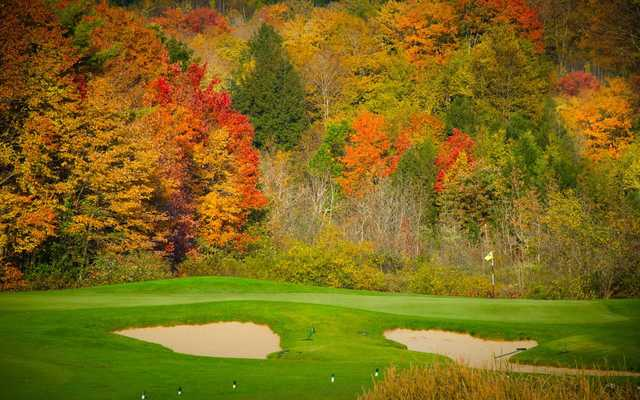 A beautiful fall view of a green at Manchester Country Club
