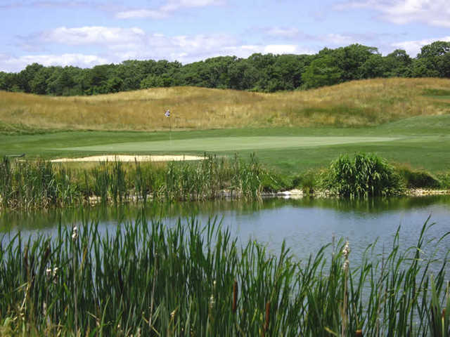 A view over the water of a hole at Mill Pond Golf Course