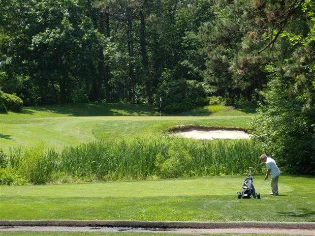 A view of a green protected by a bunker from Ocean County Golf Course at Forge Pond
