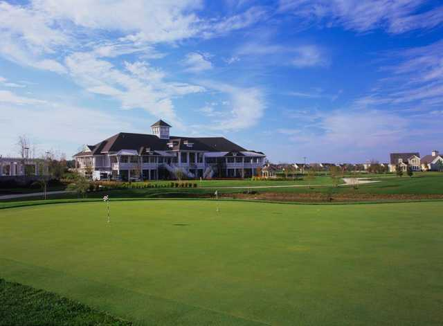 A view of the clubhouse and practice area at Heritage Shores Golf Club