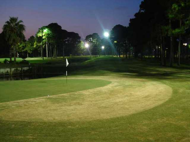 An evening view of a green with water coming into play at Golf Garden