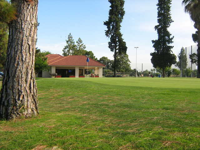 A view of a green and clubhouse at Airways Golf Course
