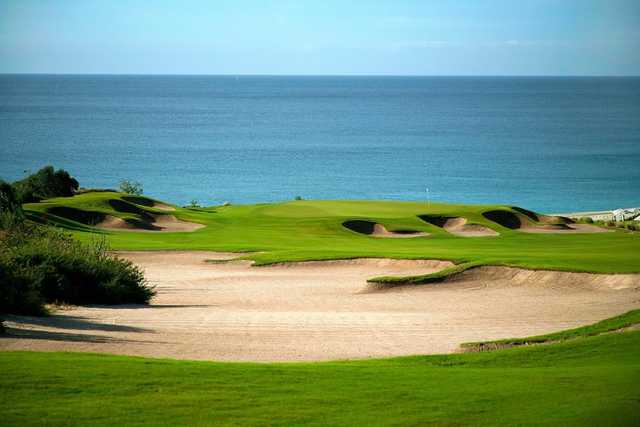 A view of a green protected by bunkers at Puerto Los Cabos Golf Club