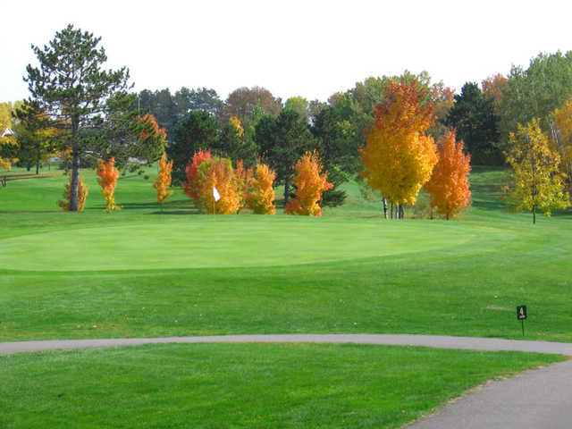 A view of green #4 protected by fall trees at Amery Golf Club