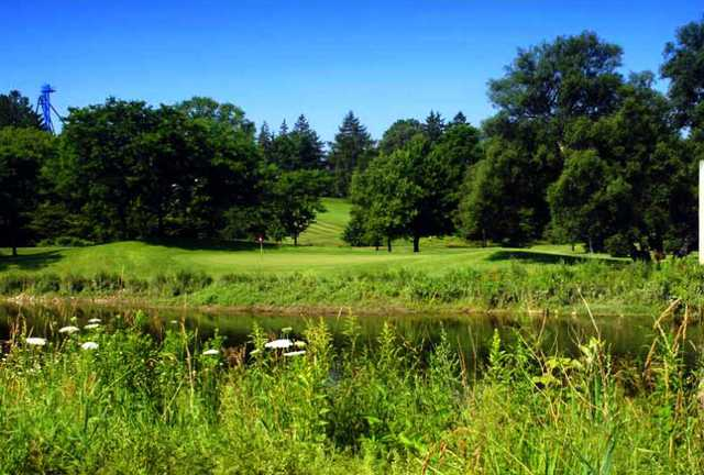A view over the water of a green at Conestoga Golf and Country Club