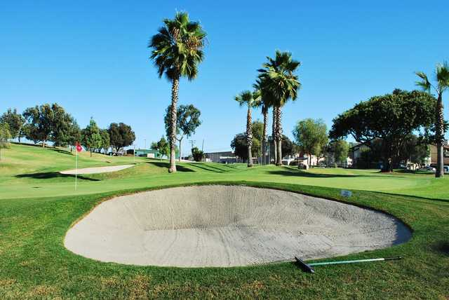 View of a bunkered hole at Colina Park Golf Course