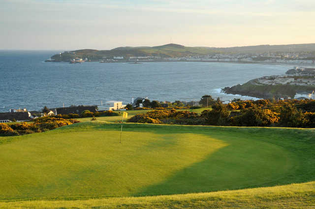 A view of the 7th green with water in background at King Edward Bay Golf & Country Club