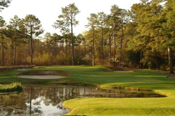 A view over the water of the 3rd green at Pine Needles Resort & Golf Club