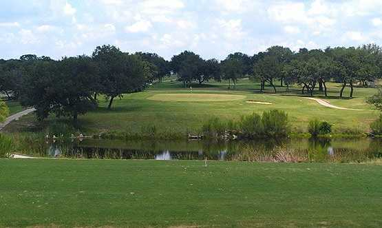 A view over the water of a green at Hidden Oaks