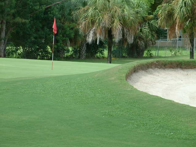 View of a green and bunker at Margate Executive Golf Course