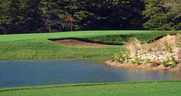 A view of a hole protected by a sand trap from Pines At Clermont