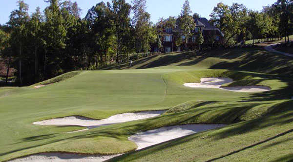 A view of a green protected by a collection of bunkers at Skybrook Golf Club