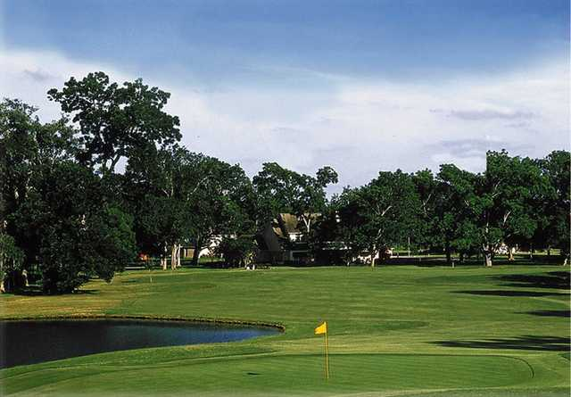 A view of a green with water coming into play at Legendary Oaks Golf Course