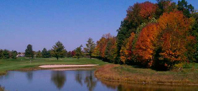 A fall view over the water of a green at The Legends Golf Club.