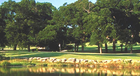 A view of a green at Pecan Valley Golf Course