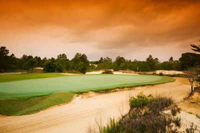 A view of a hole protected by sand traps at Dunes Golf Club