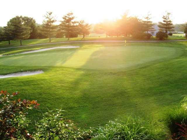 A sunny view of a hole protected by sand traps at Bowling Green Country Club