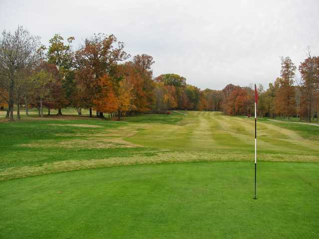 A fall view of a hole at Wooded View Golf Course