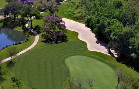 Aerial view of a green protected by a bunker from The Club at Eaglebrooke